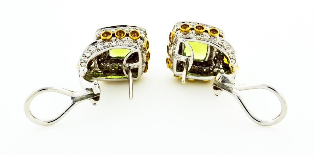 Authentic Charles Krypell fine Peridot yellow Sapphire diamond 18k white gold clip post earrings.   2 cushion Peridot approx. total weight 4.46cts, 8 x 8mm  170 full cut diamonds approx. total weight 1.46cts, F-G, VS  2 kite shaped yellow
