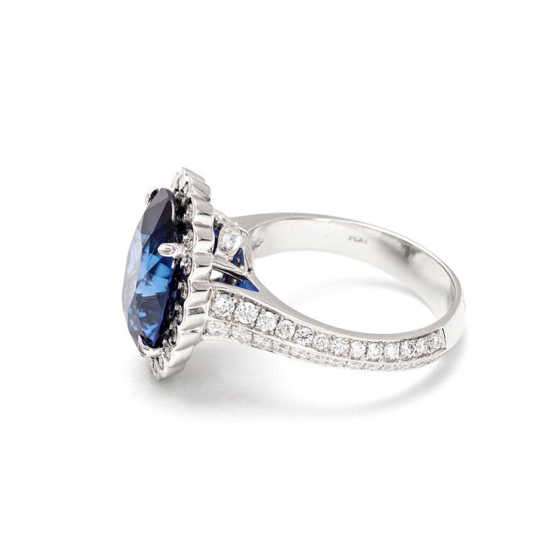 GIA Certified 6.48 Carat Oval Sapphire Diamond Halo Platinum Engagement Ring In Good Condition For Sale In Stamford, CT
