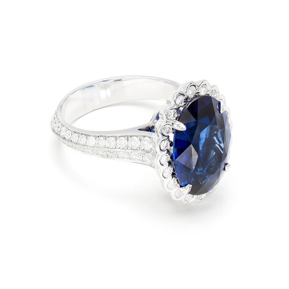Women's GIA Certified 6.48 Carat Oval Sapphire Diamond Halo Platinum Engagement Ring For Sale