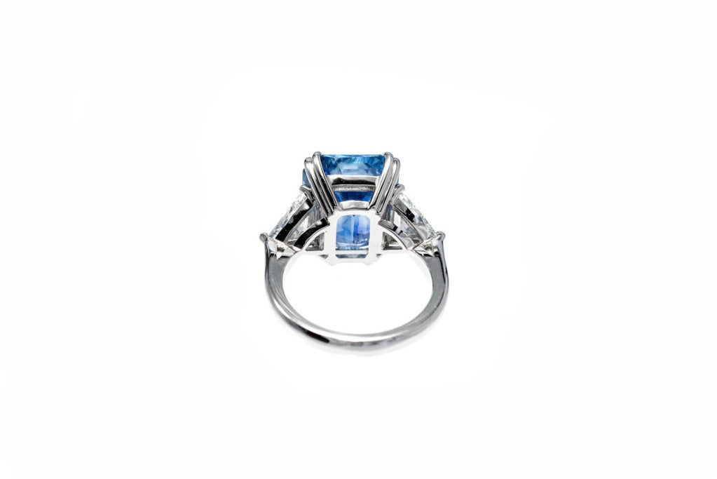 Outstanding vintage 1930 Art Deco Asscher like step cut all natural Sapphire 10.11ct. Bright and well cut, few flaws, slight color zoning. Matched with the two original triangular brilliant cut diamonds. Platinum. Excellent condition.Looks great on