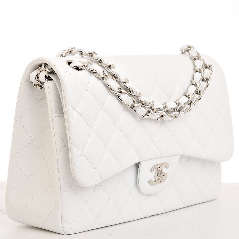 Chanel white quilted caviar leather jumbo 2.55 double flap bag with silvertone hardware, front flap with CC turnlock closure, half moon back pocket, interwoven silvertone chain link and leather adjustable shoulder strap, and the interior is lined in