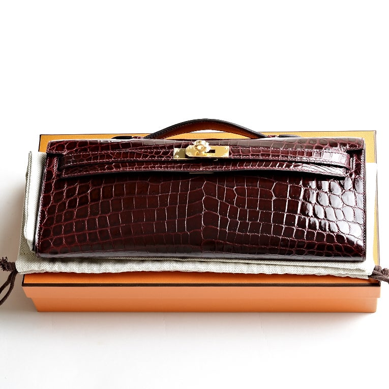 Hermes Bordeaux Shiny Niloticus Crocodile Kelly Cut with Gold ...