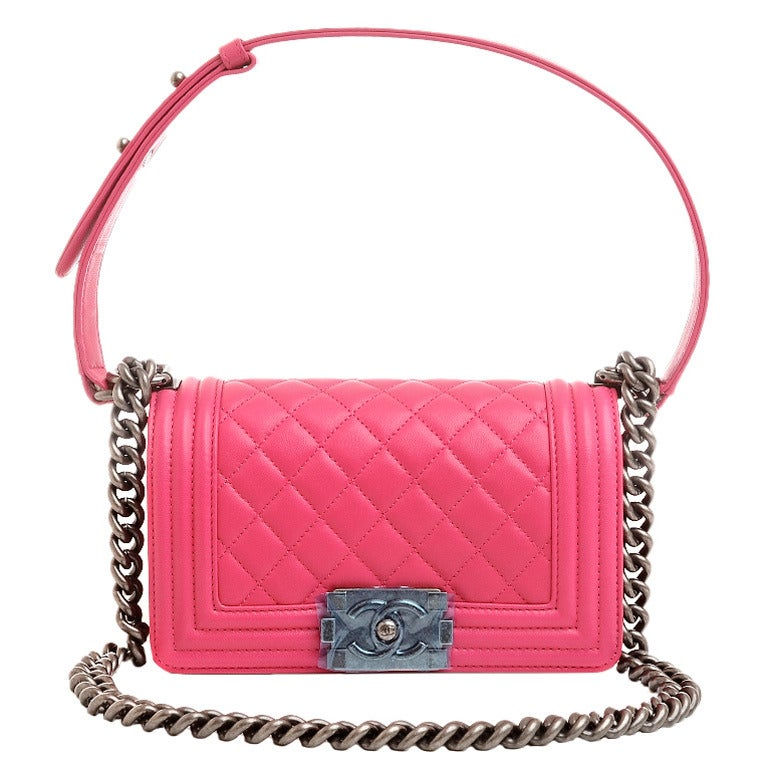 Chanel Small Boy bag of fuchsia pink lambskin leather with aged ruthenium hardware.  This bag features a full front flap with the Boy signature CC push lock closure with an aged ruthenium chain link and fuchsia pink leather padded