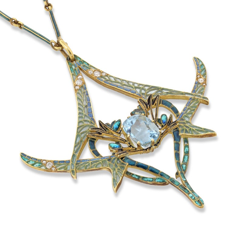 An important Rene Lalique dragonfly pendant, the pendant set to the centre with a cushion-shaped aquamarine, within an open framework of four opposing dragonflies decorated with plique-a-jour enamel wings, embellished with circular- and rose-cut