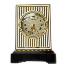 Important Cartier Art Deco Yellow Gold, Onyx and Enamel Mignonette Timepiece