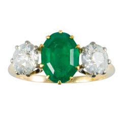 2.19 Carat Oval Emerald Diamond Gold Three Stone Ring