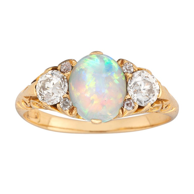 Opal Ring With  Side Diamonds On Each Side