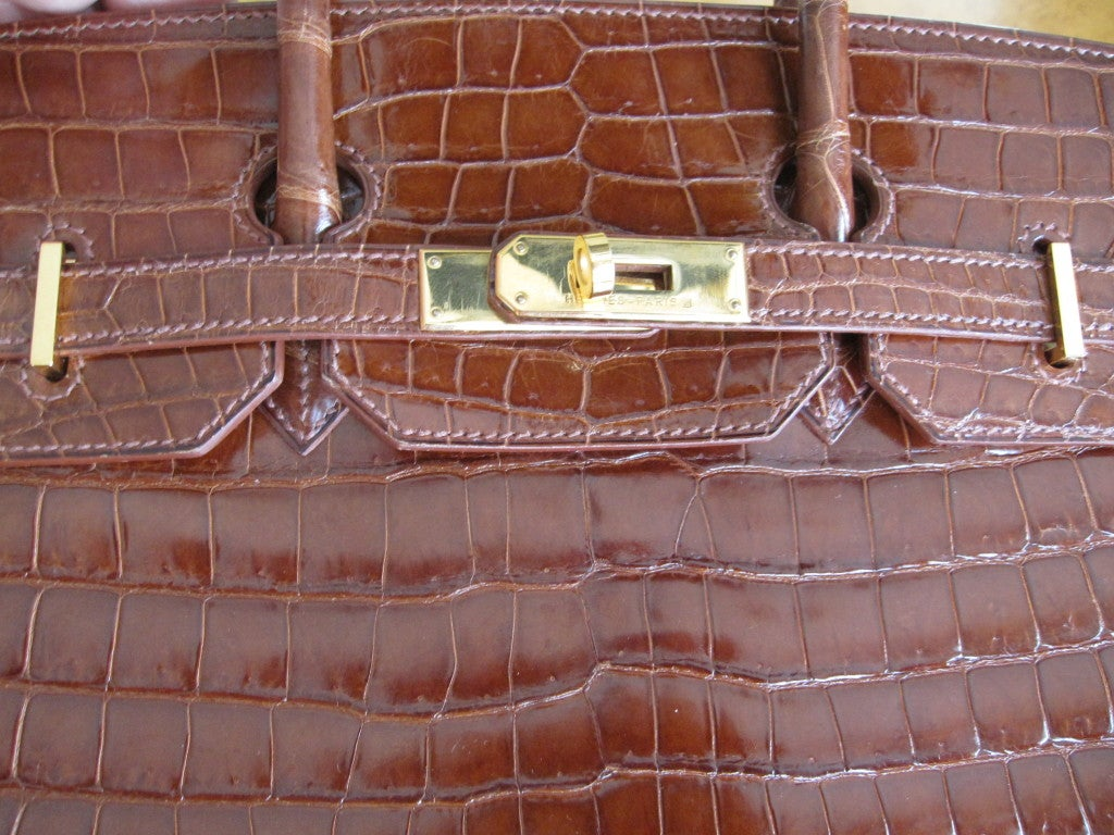 This gorgeous 35cm caramel crocodile Hermes Birkin is the ultimate luxury handbag or briefcase. Roomy enough to hold overnight belongings or a laptop, but chic enough to be carried to the most exclusive venues. Hermes calls the color