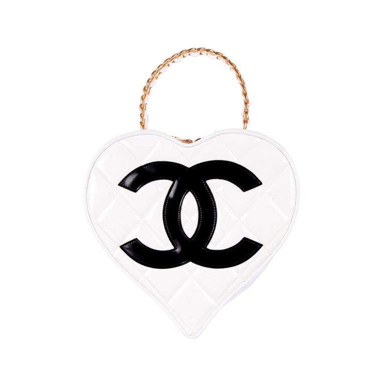 View this item and discover similar handbags and purses for sale at 1stdibs - Chanel white quilted lambskin heart bag...