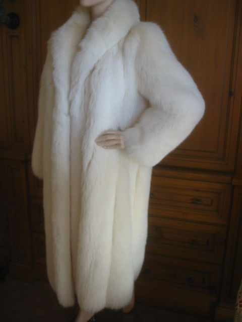 Luxurious Artic white full length fox coat from Revillon for Saks Fifth Avenue.<br /> It is in perfect, excellent condition, and was just cleaned at the Bergdorf Goodman Fur Salon.<br /> Heavy fur hooks from collar to hem.Two velvet lined slit