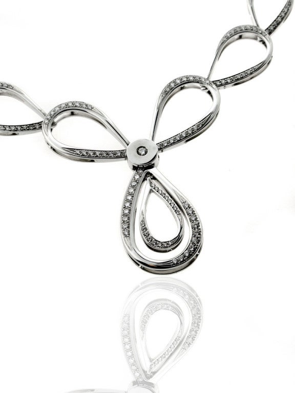 With a dual teardrop-shaped pendant and an impressive 2.95ct of round brilliant cut diamonds glittering all the way up to the the half-way point of its stylish 15″ length, this 18k white gold necklace by Pertegaz spares no expense.  Necklace Length: