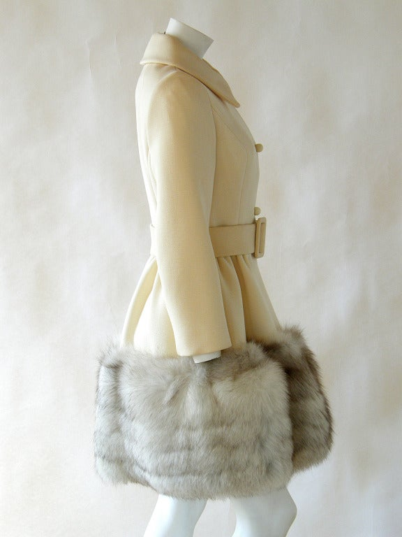 Beautifully constructed princess coat by Lilli Ann. The fitted bodice is perfectly cut, and the full skirt has a wide band of fox fur trimming the hem.  Please use Contact Dealer Button if you have any questions.