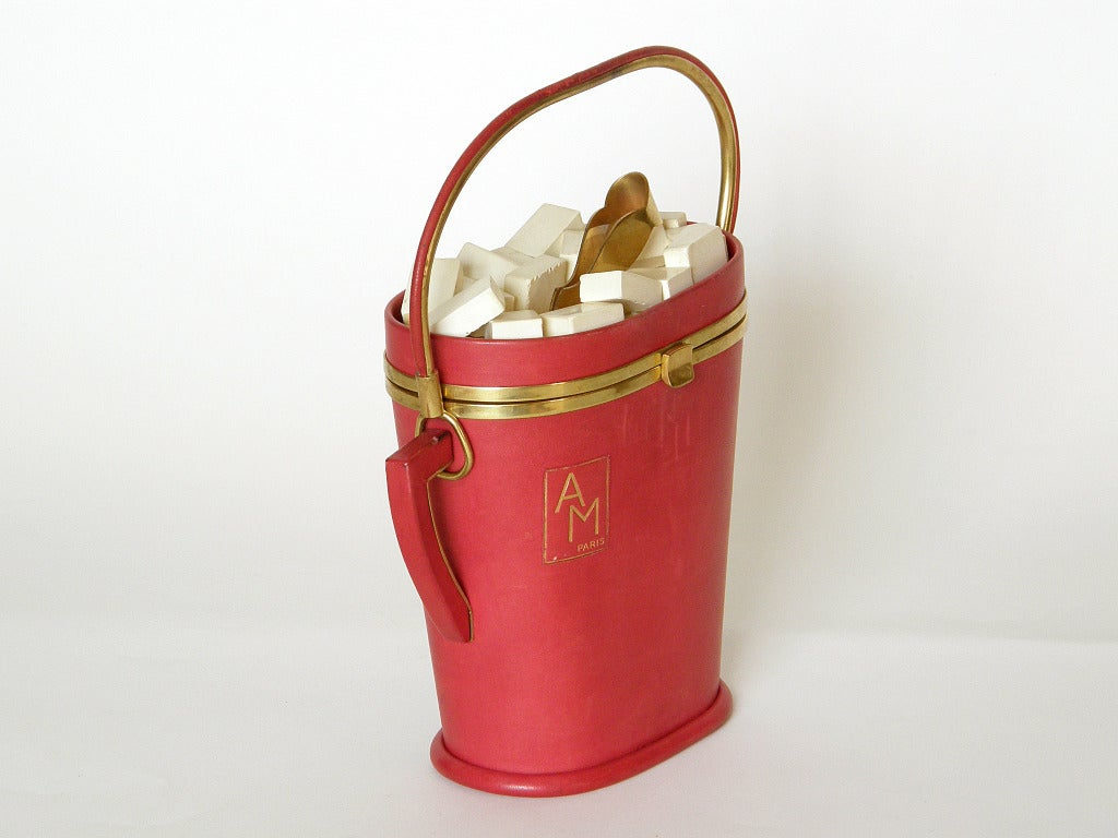 "Extremely rare sugar bowl shaped handbag by Anne-Marie. The bag is covered in red leather with white painted wood sugar cubes and gold-plated tongs. The front has a label with ""AM Paris"" printed in gold.