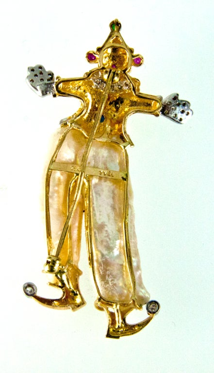 Featuring a Unique Vintage Multi-gem Clown Pin Pendant, hand crafted in 18k Yellow Gold; the clown is wearing Cultured Freshwater Pearl Pants and diamonds on the toes, hands,  suit and around his neck; accented by twinkling ruby, sapphire and