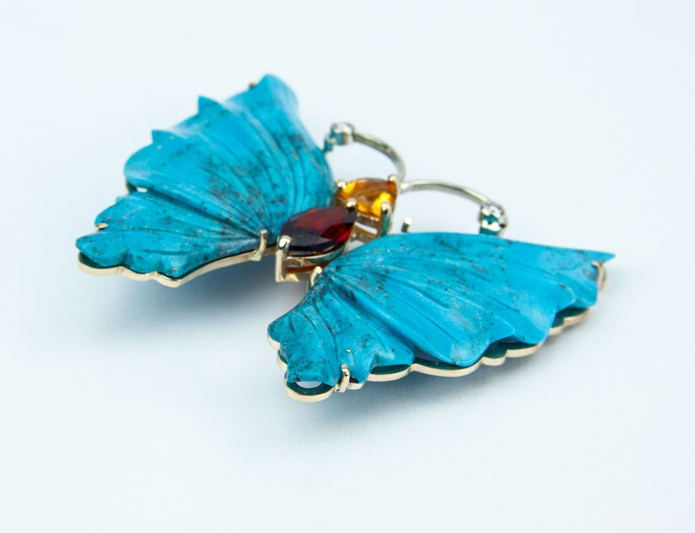 Beautiful Statement Natural Turquoise Butterfly Brooch Pin Pendant; the antennae are bezel set with diamonds and the head with a Trillion Citrine and the body a Marquis Garnet ; beautifully hand crafted in14k yellow Gold; measuring approx. 2