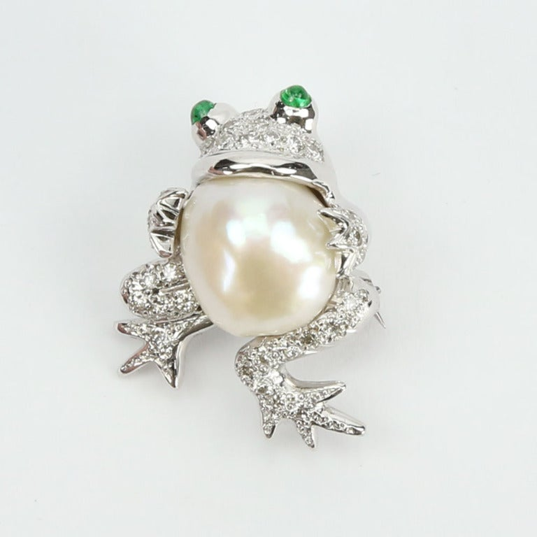 Beautiful and Whimsical pair of Frog Brooches; each set with a Sensational South Sea Pearl in the belly, Diamond body and Emeralds in the Eyes; mounted in handmade 14K white gold mounting; Simply adorable! Ready to wear from day to evening with