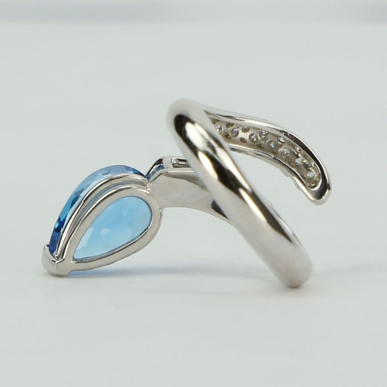Beautiful Swiss Blue Topaz and Diamond Snake Ring, handmade in 14k white  gold; ring size: 6.5; Approx. weight of pear shaped Blue Topaz: 4.69 ct.; Diamond weight: 0.70 ct. Chic and Timeless...Illuminating your look with a touch of Classic!