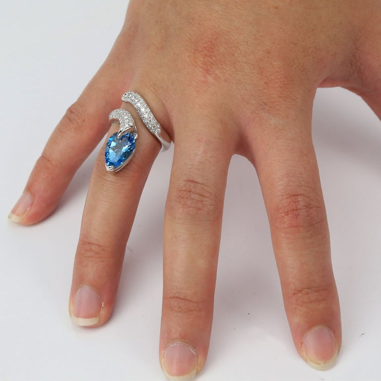 Modernist Swiss Blue Topaz and Diamond Gold Snake Serpent Ring Estate Fine Jewelry For Sale