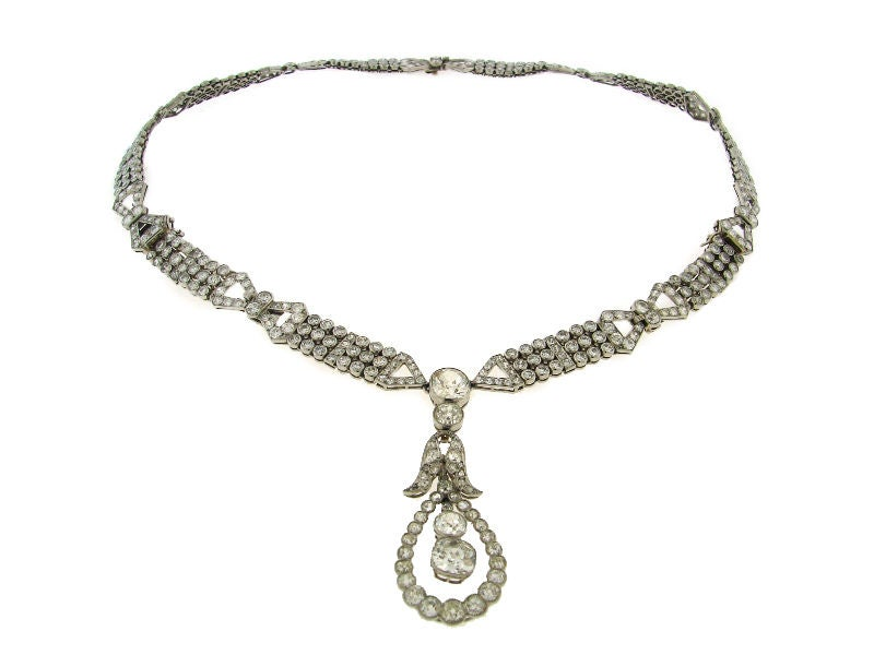 Unique and very important Art Deco diamond & platinum set consisting of interchangeable necklace/bracelet and earrings created in France in the 1920's. 