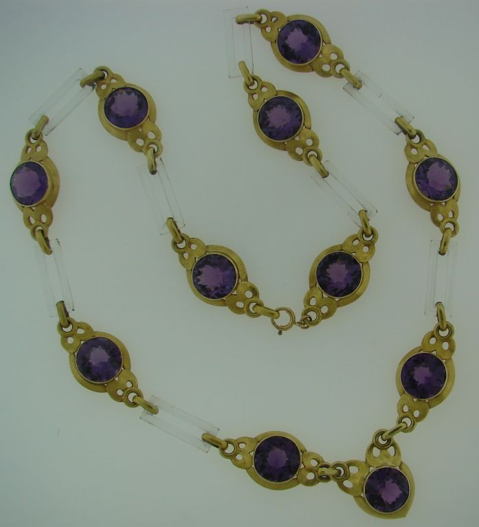 Stunning one-of-a-kind necklace created by Cartier New York in 1931. It is made of yellow gold and horn and set with beautiful deep purple amethyst. The gold has a special unique finish because of the little grooves made with hammered by hand dots.