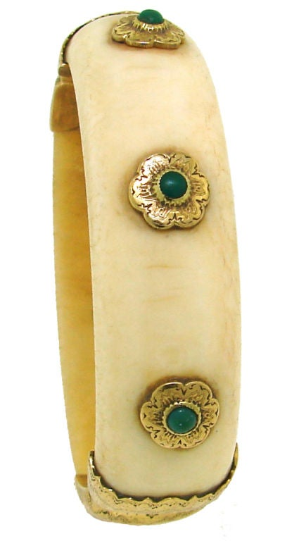 Beautiful bangle created by Buccellati in Italy in the 1950's.<br /> Convex ivory accentuated with turquoise cabochon set in yellow gold with famous finest Buccellati finish.<br /> The bangle is slightly under 3/4
