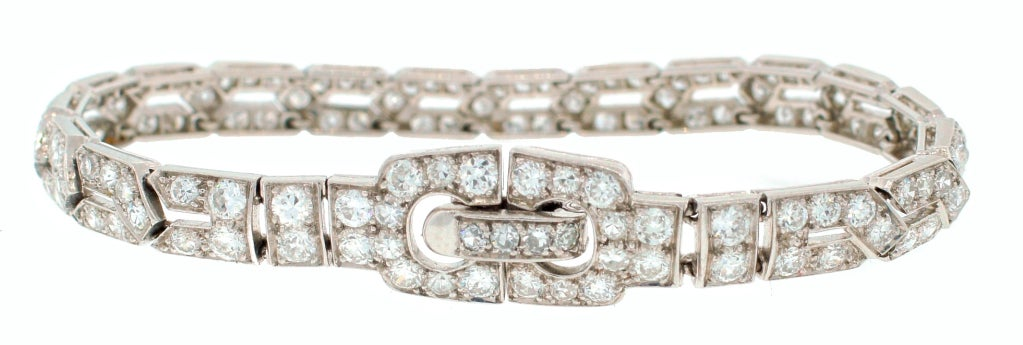Delicate timeless and classic Art Deco bracelet created by Cartier in the 1920's. The bracelet is made of platinum and set with Old European cut diamonds (total weight approximately 7.50 carats). The bracelet measures 6-1/4 x 1/4 inches (16 x 0.6