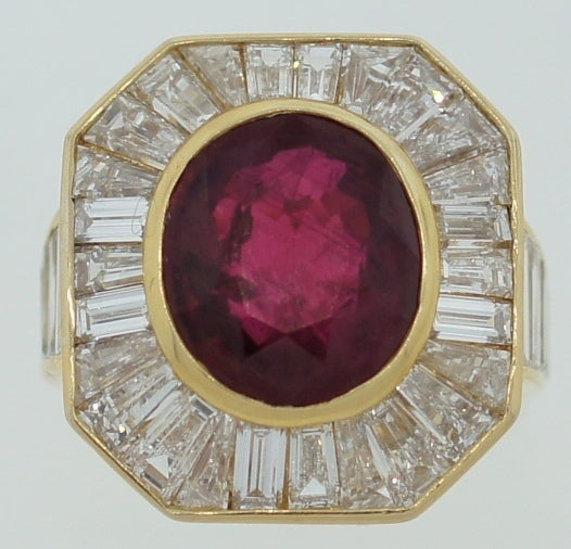 Stunning and chic cocktail ring created by Van Cleef & Arpels in France in the 1970's. Features a 5.66-ct oval natural Burmese ruby set in yellow gold and surrounded with pre-cut baguette and tapered baguette cut diamonds.