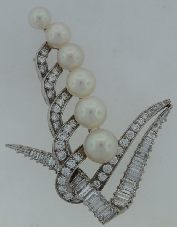 Fabulous Lily of the Valley brooch created by Cartier in the 1950's-60's. Gracious lines, perfect proportions, tasteful material selection. Cartier sophistication and outstanding workmanship. Features six Akoya pearls, round and baguette cut