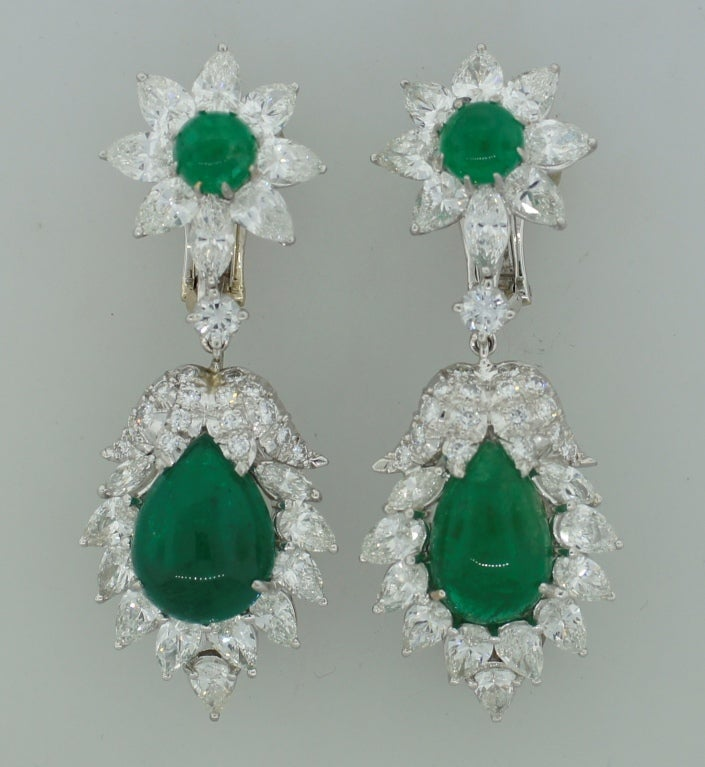 Stunning interchangeable earrings created by David Webb in the 1970's. Feature cabochon emeralds surrounded with diamonds set in platinum. 