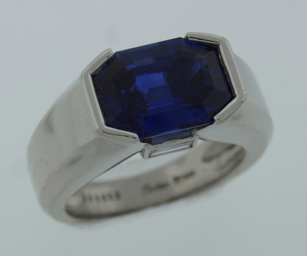 Magnificent sapphire ring with diamond accents created by Cartier. Features a 6.57-ct natural non-treated Burmese sapphire accompanied with a certificate from Swiss Gemological Institute (see pic.10). The setting is made of platinum and set with two
