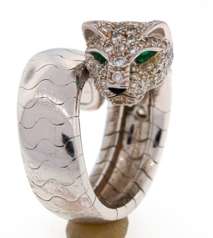 Signature Cartier Panthere ring - desirable and hot! Made of 18kt white gold and set with diamonds. The panther's eyes are accented with emeralds.   French size 51, US size 6. The ring stretches a little bit, so it fits a finger 5.5-6