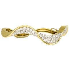 A Gold and Diamond Undulating Bangle