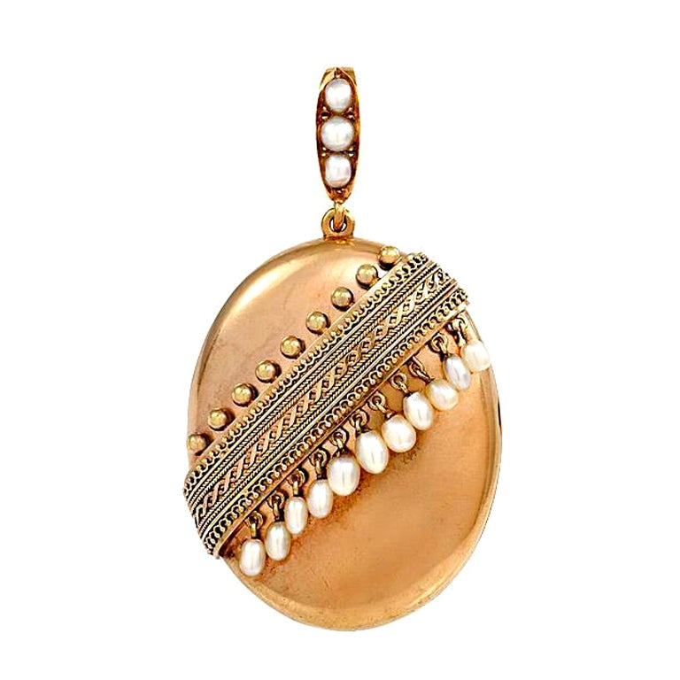 An Antique Gold Locket With Pearl Accents