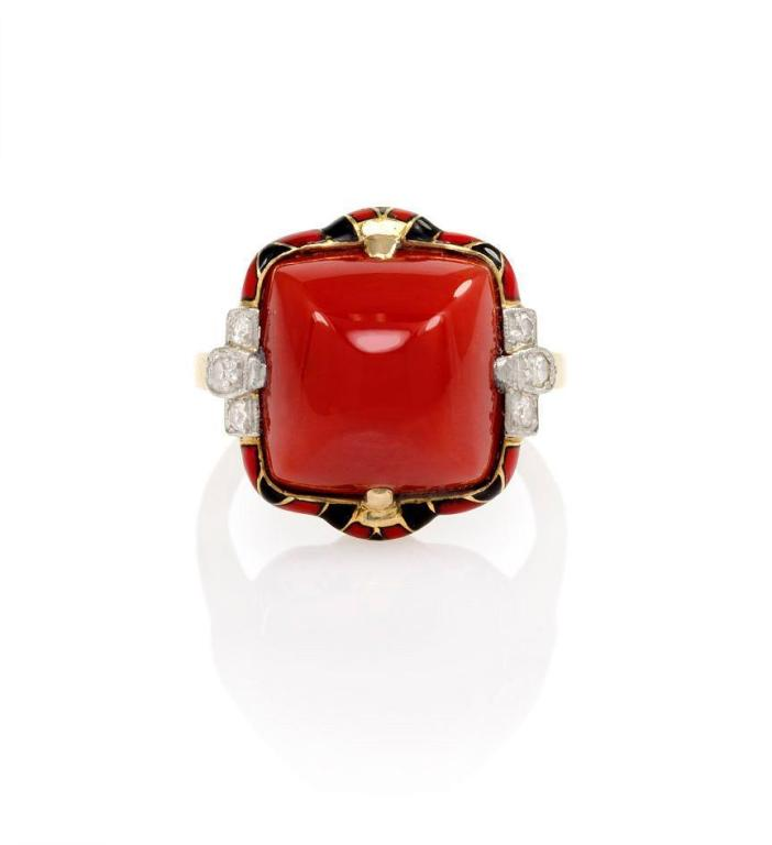 An Art Deco coral ring with red and black enamel decoration and diamond accents, in 14k gold and platinum.  Signed FFF.