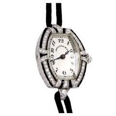 C.H. Meylan Lady's Platinum, Diamond and Onyx Art Deco Tonneau Wristwatch