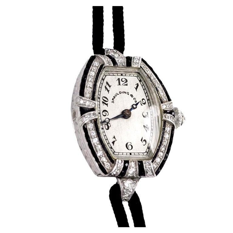 C.H. Meylan Lady's Platinum, Diamond and Onyx Art Deco Tonneau Wristwatch For Sale