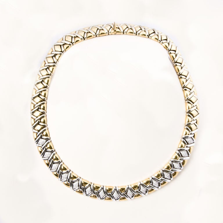 Exquisite craftmanship, this 18kt. yellow and white gold mount choker necklace is bead set across the front in 15 paved marquaise shape sections with 155 round brilliant cut diamonds totaling approx. 2.0 cts., grading VVS1-VS1 clarity G color