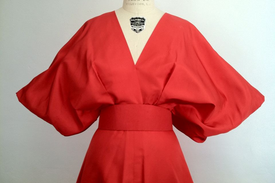 A fine and rare vintage Pauline Trigere gown. Exquisite coral silk