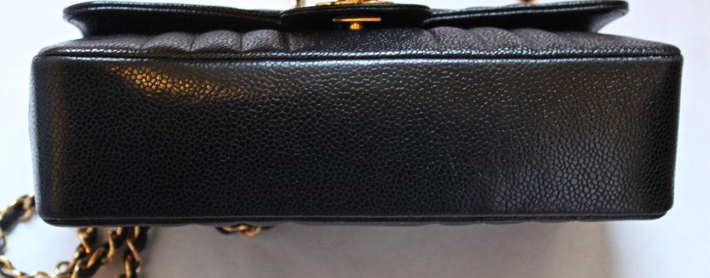 CHANEL black caviar Mademoiselle flap bag with gilt chain 2