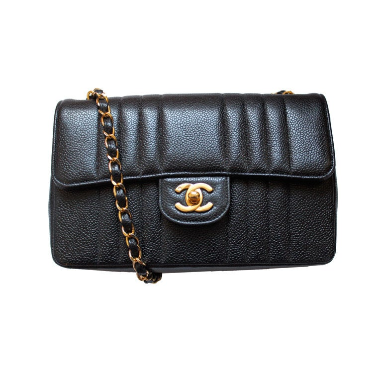 CHANEL black caviar Mademoiselle flap bag with gilt chain 1