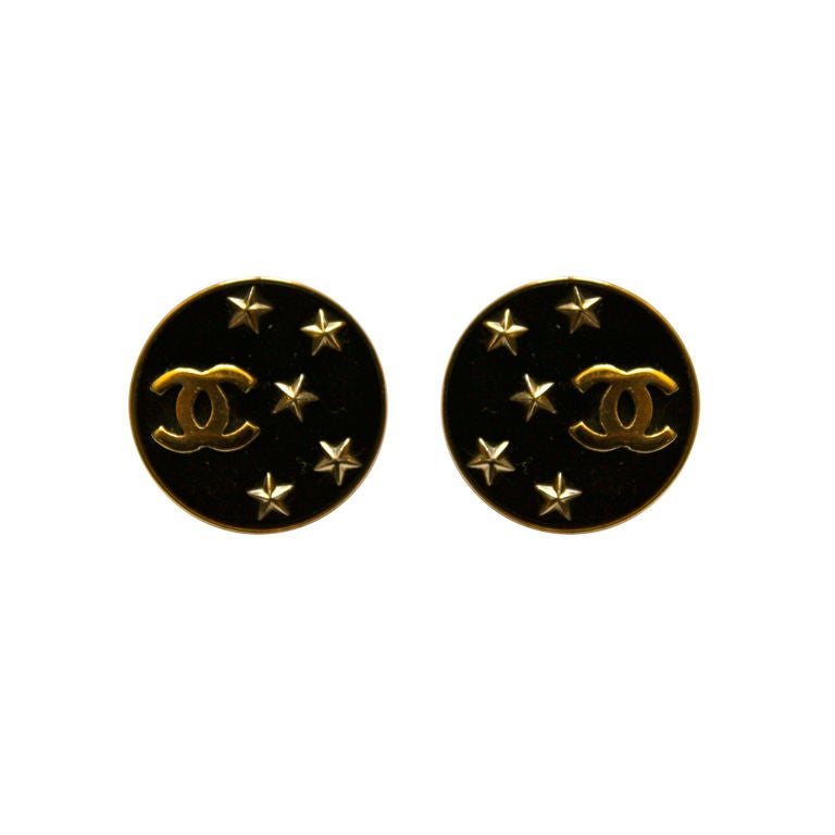 CHANEL black earrings with gilt CCs and stars 1