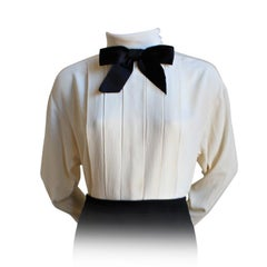 CHANEL BOUTIQUE cream silk blouse with pintucks and black bow