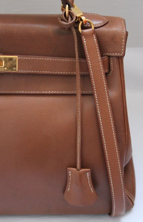 HERMES gold courchevel 32 cm KELLY with gilt hardware and strap at ...