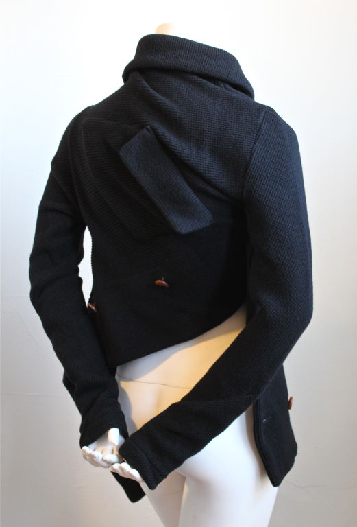 Asymmetrical jet black wool sweater from Comme des Garcons. Labeled a size 'M'. Made in Japan. New with tags.