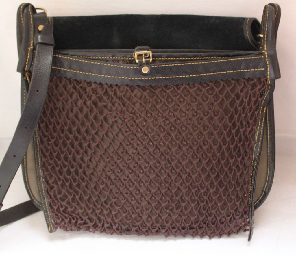 """Very rare large weathered black textures leather bag with extra long strap and net detail from Comme Des Garcons dating to the 1980's. Bag measures 16"""" wide by 12"""" tall by 4"""" think with an adjustable strap (39""""-48"""") Various compartments. Made in"""