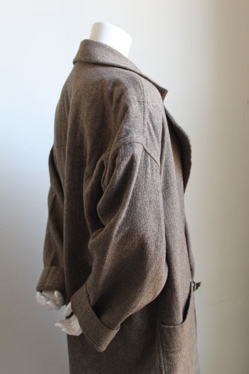 Textured brown wool coat with horn button closure and large patch pockets from Issey Miyake plantation dating to the 1980's. Fits a size M-XL. Made in Japan. Very good condition.