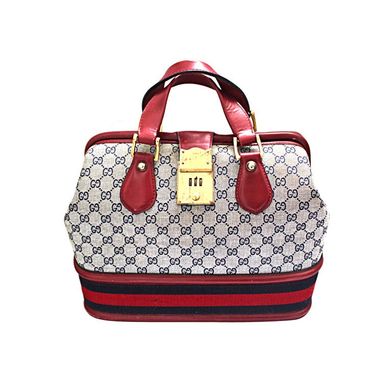 GUCCI monogrammed canvas & red leather travel bag 1