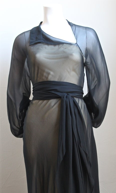 Delicate navy chiffon asymmetrical gown with cream slip from Halston dating to the 1970s. Best fits a US 2 or 4. Made in the U.S. Very good condition.