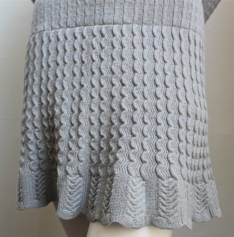 """Gorgeous blue knit wool dress with crocheted detail from Alaia dating to the 1990's. Fits a size small. 32"""" in length. Very soft and stretchy knit. Hidden built in shorts. Made Italy. Excellent condition."""