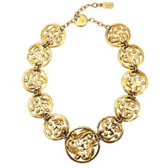 YVES SAINT LAURENT gilt necklace with scroll pattern